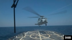 FILE - A SH-60 Seahawk helicopter takes off from the flight deck of USS Jason Dunham during a joint exercise with the Montenegrin navy March 16, 2015 in the Mediterranean Sea.