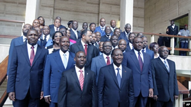 The new Ivory Coast government pose with President Alassane Ouattara after a council, at the Presidential Palace in Abidjan June 3, 2011
