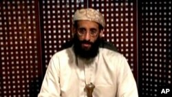 Anwar al Awlaki, a US-born cleric linked to al-Qaida's Yemen-based wing, gives a religious lecture in an unknown location in this still image taken from video released by Intelwire.com on September 30, 2011.