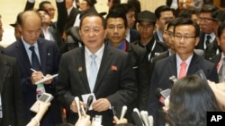 North Korea Foreign Minister Ri Yong Ho talks to a reporter after a break during the 23rd Asean Regional meeting in Vientiane, Laos, Tuesday, July 26, 2016.