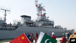 In this picture released by the Pakistan Navy, warships, including those from China, are welcomed at the Karachi dock to take part in the Multi-National Naval exercises 'AMAN 07' in Karachi, Pakistan (FILE).