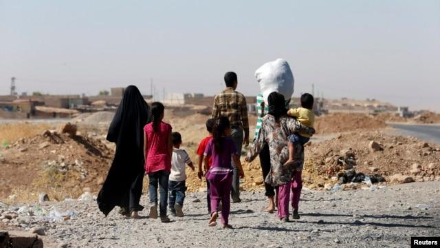 Một gia đình người sắc tộc thiểu số Yazidi tại Mosul, ngày 21/8/2014.