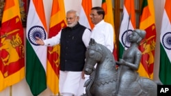 Sri Lanka's President Maithripala Sirisena, right, and Indian Prime Minister Narendra Modi walk towards a meeting room in New Delhi, India, Monday, Feb. 16, 2015.