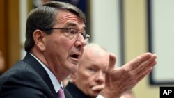 Defense Secretary Ash Carter, left, testifies before the House Armed Services Committee on Capitol Hill in Washington, June 17, 2015. Joint Chiefs of Staff Chairman Gen. Martin Dempsey listens at right.