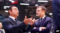 Fransa Cumhurbaşkanı Emmanuel Macron, Carlos Ghosn'u dinlerken (arşiv)