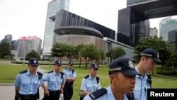 Police patrol outside the Legislative Council building in Hong Kong, June 11, 2019.