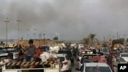 With Islamic State militants launching a fierce offsensive, people leave their hometown Ramadi, 70 miles (115 kilometers) west of Baghdad, Iraq, April 16, 2015.