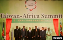 FILE - From left, the presidents of Malawi, Burkina Faso and Taiwan; the king of Swaziland; the president of Sao Tome and Principe; and the vice president of Gambia attend the opening ceremony of the first Taiwan-Africa Heads of State Summit in Taipei, Sept. 9, 2007. As of May 26, 2018, Swaziland alone in Africa has diplomatic ties with Taiwan.