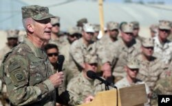 FILE - The commander of NATO and U.S. forces in Afghanistan, U.S. Army Gen. John W. Nicholson speaks during a change of command ceremony at Task Force Southwest atn Shorab military camp of Helmand province, Afghanistan, Jan. 15, 2018.