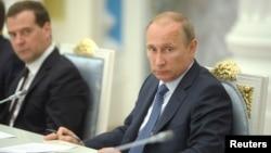 Tổng thống Nga Vladimir Putin chủ trì cuộc họp về các vấn đề kinh tế và xã hội tại Moscow, ngày 7/5/2014.
