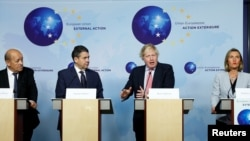Britain's Foreign Secretary Boris Johnson (2-R) attends a news conference with French Foreign Minister Jean-Yves Le Drian (L), German counterpart Sigmar Gabriel (2-L) and EU's foreign policy chief Federica Mogherini (R), in Brussels, Belgium, Jan. 11, 2018.