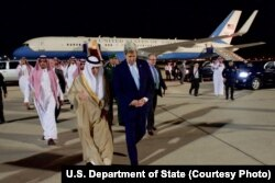 U.S. Secretary of State John Kerry, right, walks with Saudi Arabia Foreign Minister Adel al-Jubeir, at Jeddah International Airport in Jeddah, Saudi Arabia, May 14, 2016.