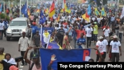 FILE - Protesters, bearing the flags of opposition parties, demonstrate against President Joseph Kabila remaining in power if the presidential election is not held before the end 2016, in Kinshasa, May 26, 2016.