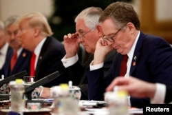 U.S. Trade Representative Robert Lighthizer (R) and U.S. Secretary of State Rex Tillerson (2nd R) attend bilateral meetings between U.S. President Donald Trump and China's President Xi Jinping at the Great Hall of the People in Beijing, China Nov. 9, 2017