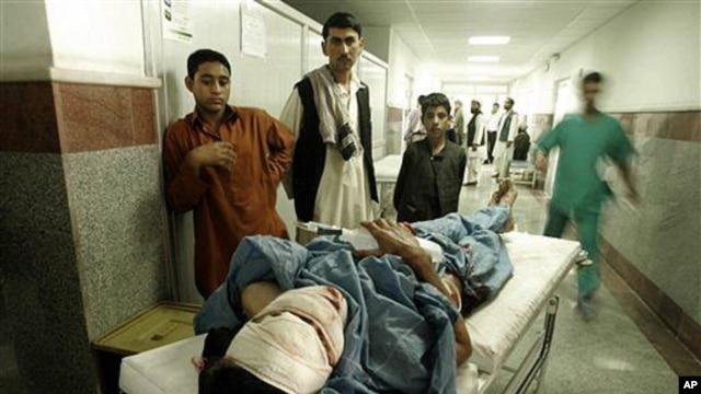 A man injured in a roadside bomb blast lies on a stretcher in a hospital in Herat, west of Kabul,  18 Oct 2010