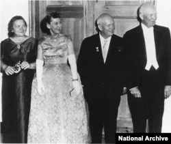 The Eisenhowers and Khrushchevs at a state dinner in 1959. The Soviet's successful launch of the first man-made satellite, Sputnik, intensified the competition between the countries.