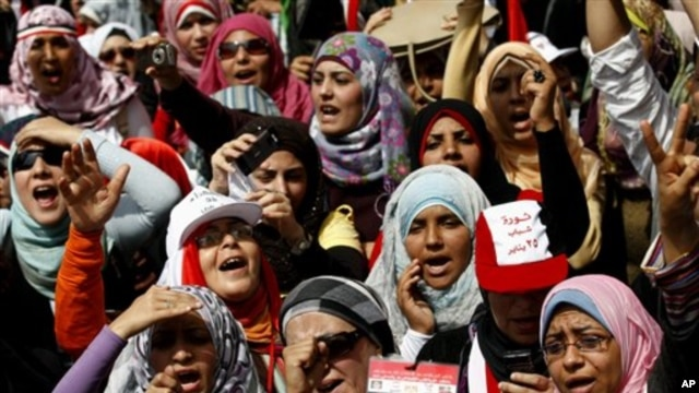 Egyptian women chant slogans as they attend a demonstration in Tahrir Square in Cairo, Egypt, April 1, 2011