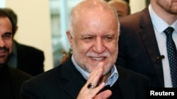 FILE - Iranian Oil Minister Bijan Zanganeh wave to journalists as he arrives for a meeting of OPEC oil ministers at OPEC's headquarters in Vienna, Austria, Dec. 4, 2013.