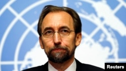 FILE - Jordan's Prince Zeid Ra'ad Zeid al-Hussein, U.N. High Commissioner for Human Rights, pauses during a news conference at the United Nations European headquarters in Geneva, Oct. 16, 2014.