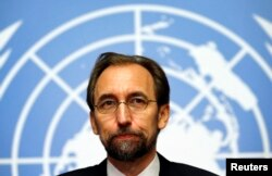 FILE - Jordan's Prince Zeid Ra'ad al-Hussein, U.N. High Commissioner for Human Rights, pauses during a news conference at the United Nations European headquarters in Geneva, Oct. 16, 2014.