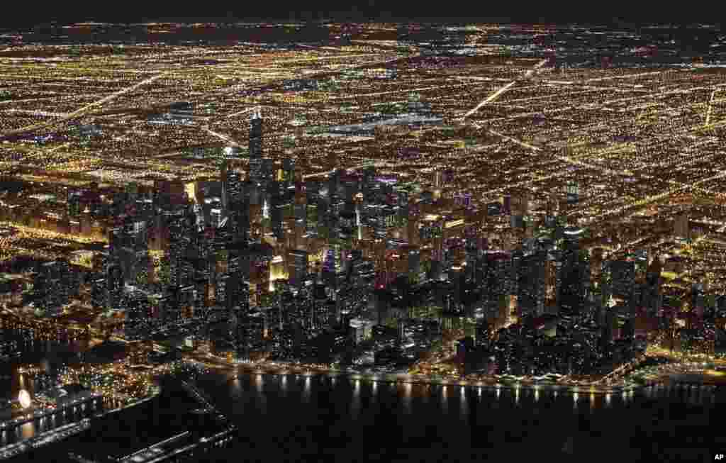 An aerial view of the downtown Chicago, Illinois skyline, on the night of Nov. 24, 2013