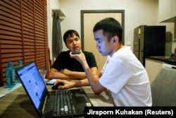 Tattep Ruangprakitseree and his partner Panumas Singprom, also a member of the commitee of Free People group, sit in a flat in Nonthaburi province, in Thailand August 22, 2020.