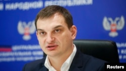 Глава избирательной комиссии самопровозглашенной Донецкой народной республики Роман Лягин на пресс-конференции в Донецке 28 октября 2014 г.