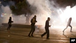 Israel's mainly Jewish Ethiopians clash with Israeli riot police during a protest against racism and police brutality in Tel Aviv, Israel, Sunday, May 3, 2015.