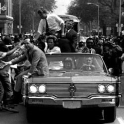 The Democratic presidential hopeful, Sen. Robert F. Kennedy, attracted crowds of young blacks during a tour down Detroit's Twelfth Street, May 15, 1968