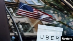 An Uber sign is seen on a car in New York City.