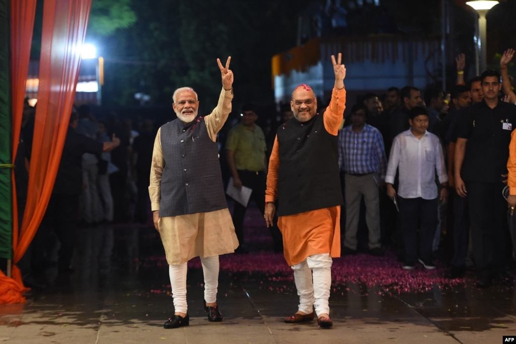 Indian Prime Minister Narendra Modi (L) and president of the ruling Bharatiya Janata Party (BJP) Amit Shah celebrate victory in India's general elections, in New Delhi.