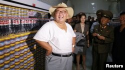 North Korean leader Kim Jong Un visits a factory in this undated photo released by North Korea's Korean Central News Agency, Aug. 7, 2018.