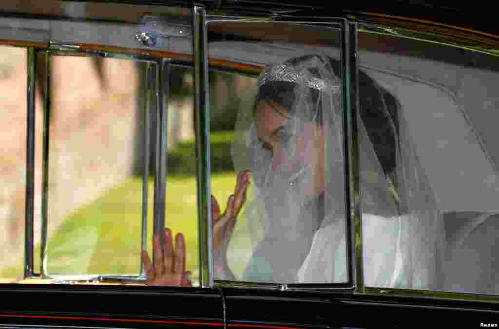 Meghan Markle leaves the Cliveden House Hotel, for her wedding at St George's Chapel at Windsor Castle to Prince Harry in Taplow, Britain, May 19, 2018.