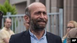 Erdem Gul, Ankara Bureau Chief of Cumhuriyet newspaper, speaks outside city's main courthouse in Istanbul, Sept. 21, 2016.