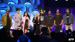(L-R) Usher, Rihanna, Nicki Minaj, Madonna, Deadmau5, Kanye West, JAY Z, and J. Cole onstage at the Tidal launch event #TIDALforALL at Skylight at Moynihan Station on March 30, 2015, in New York City.