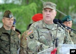 FILE - U.S. Army Chief of Staff General Mark Milley speaks during the opening ceremony of the Anaconda-16 military exercise, in Warsaw, Poland, June 6, 2016.