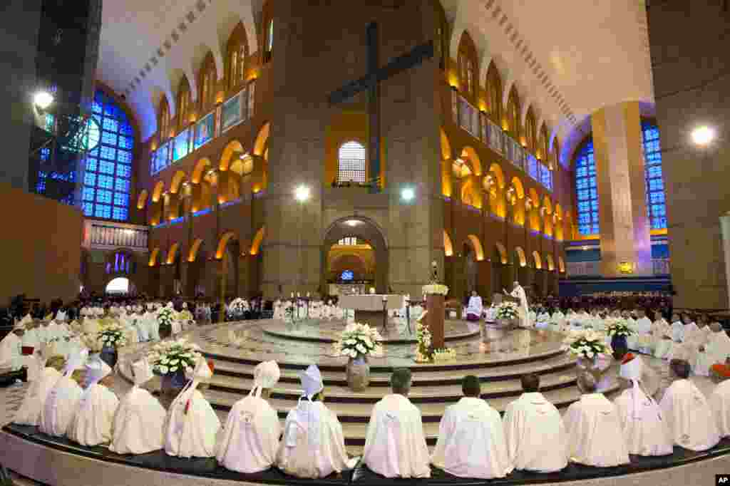 Members of the clergy listen to Pope Francis as he gives Mass inside Aparecida Basilica, Brazil, July 24, 2013.