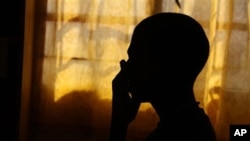 The silhouette of an 18-year-old South African orphan, whose mother died of AIDS when he was 14 (file photo)