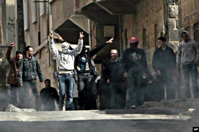 FILE - Anti-Syrian government demonstrators take to the streets in the southern city of Daraa, March 23, 2011.