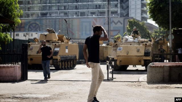 Trucks and APC's of Egyptian riot police are parked outside the Egyptian Museum near the main access to Egypt's landmark Tahrir square on August 20, 2013 in Cairo, Egypt.