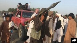 Taliban fighters gather in Surkhroad district of Nangarhar province, east of Kabul, Afghanistan, June 16, 2018.