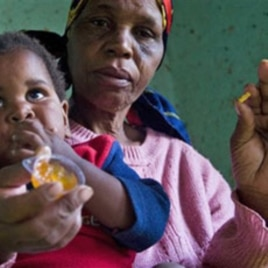HIV positive child is given some jam prior to her ARV, near Durban, South Africa, 30 Nov 2010
