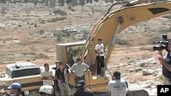 Just Vision produces documentaries, such as 'Budrus,' which highlights the nonviolent efforts of both Palestinians and Israelis to protest Israel's plan to destroy a Palestinian village by building a separation wall.