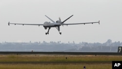 FILE- Unmanned Predator B drone, taken November 8, 2011.