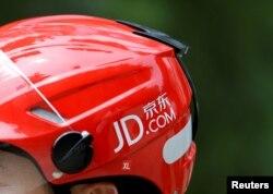 FILE - A logo of JD.com is seen on a helmet of a delivery man in Beijing, June 16, 2014.