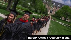 FILE: Barclay College graduates Taylor Mabry and Ryan Kucharek walk across campus to commencement ceremonies. Haviland, Kansas. May 2019