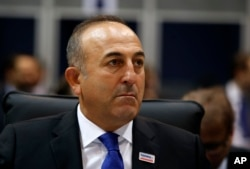FILE - Turkish Foreign Minister Mevlut Cavusoglu attends the opening session of the OSCE Ministerial Council, in Belgrade, Serbia, Dec. 3, 2015.