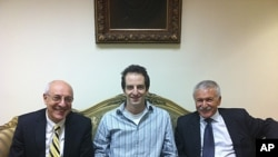 In a photo made available by the office of Israeli Knesset Member Israel Hasson October 26, 2011, shows Ilan Grapel (center), a U.S.-Israeli citizen arrested in Egypt between Israel Hasson, right, and lawyer Yitzhak Molcho, left, in Cairo, Egypt.