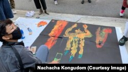 Thai pro-democracy protesters produce art piece as part of protest in front of the Royal Thai Consulate General New York on September 19, 2020