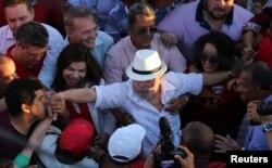 Former Brazilian President Luiz Inacio Lula da Silva, center, attends a rally in the northeastern city of Penedo in Alagoas, Brazil, Aug. 22, 2017.